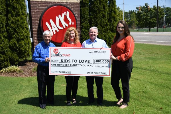 JFF presents check to Kids to Love